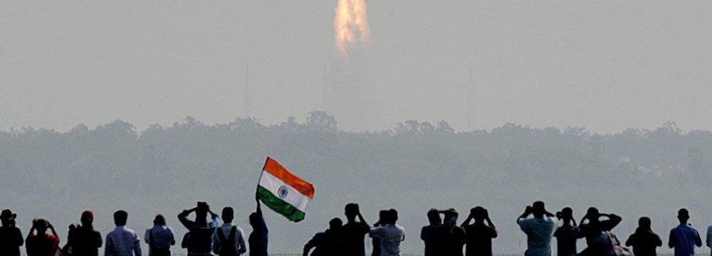Onlookers watch the launch of satellites at Sriharikota, India, on Feb. 15.