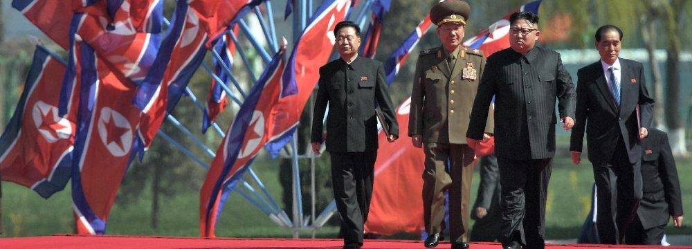 Kim Jong-un (2nd R) on April 13