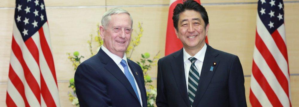 James Mattis (L) and Shinzo Abe meet in Tokyo, Japan, on Feb. 3