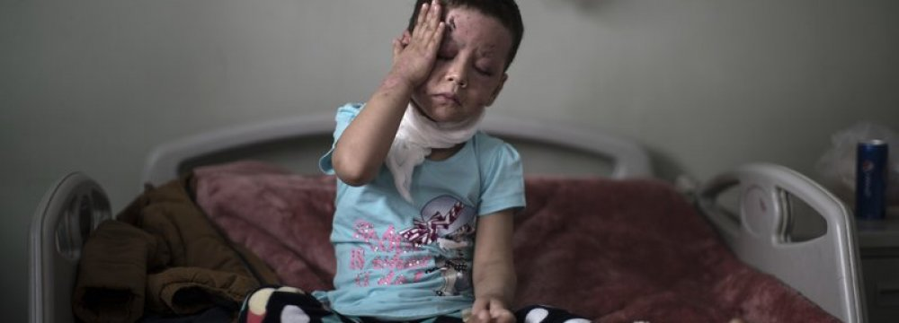 Hawra Alaa Hassan, 4 years old, who was badly  burnt in a US airstrike in Mosul, is seen in  a hospital in Irbil, Iraq, on April 8. (File Photo)