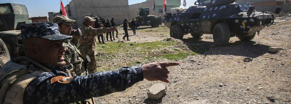 Iraqi forces advance toward Dindan neighborhood in West Mosul, Iraq, on Feb. 25.