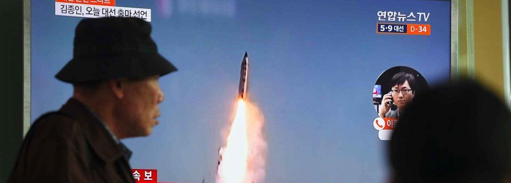 A news program reports North Korea's missile firing in Seoul, South Korea, on April 5.