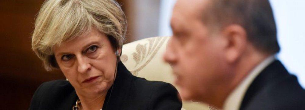 British Premier Theresa May (L) and Turkish President Recep Tayyip Erdogan meet in Ankara, Turkey, on Jan. 28.