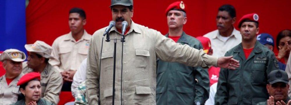 Venezuela's President Nicolas Maduro (C) speaks at Miraflores Palace in Caracas, Venezuela, on April 17.