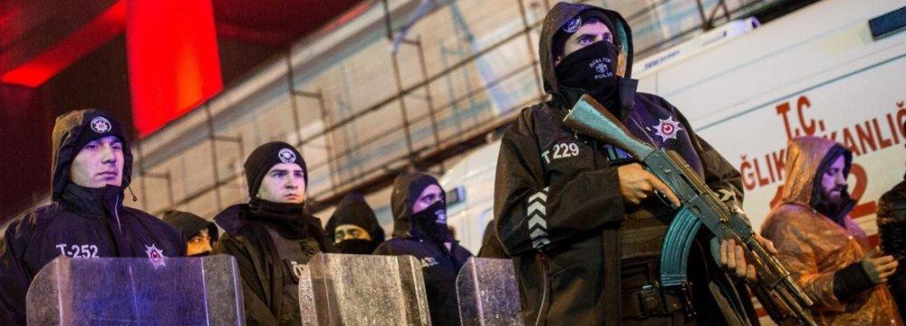 Turkish police secure the area at Ortakoy District under Bosphorus Bridge in Istanbul on Jan. 1.