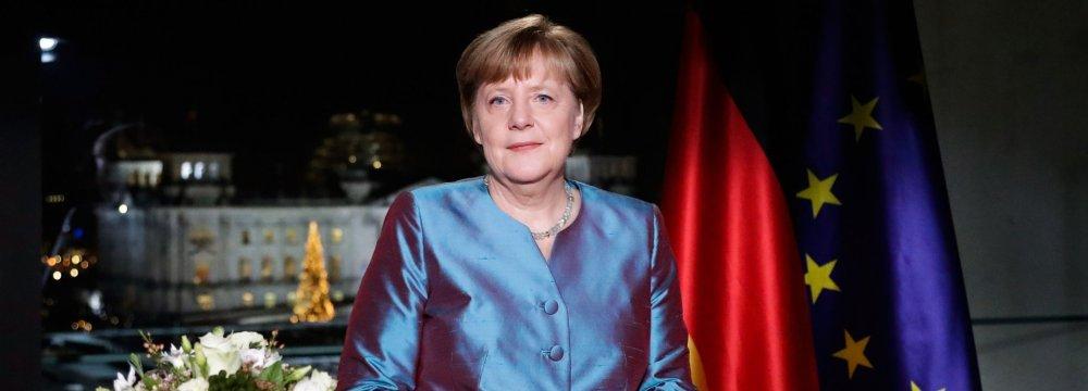 Merkel Defends Refugee Plan in New Year Message