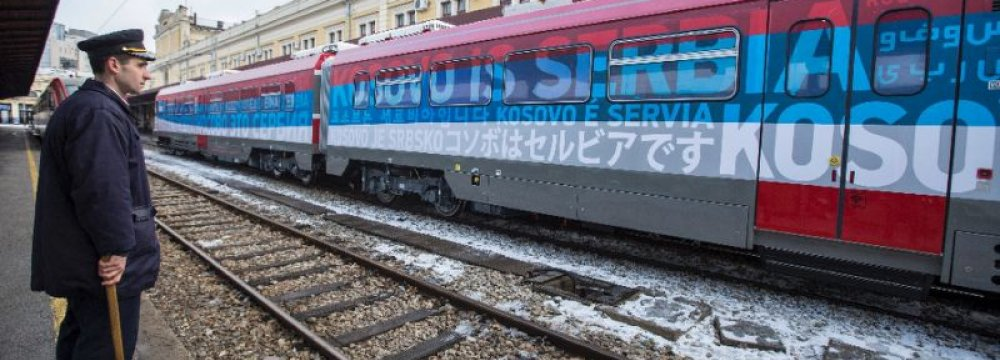 """The train with the words """"Kosovo is Serbian"""" written in different languages"""