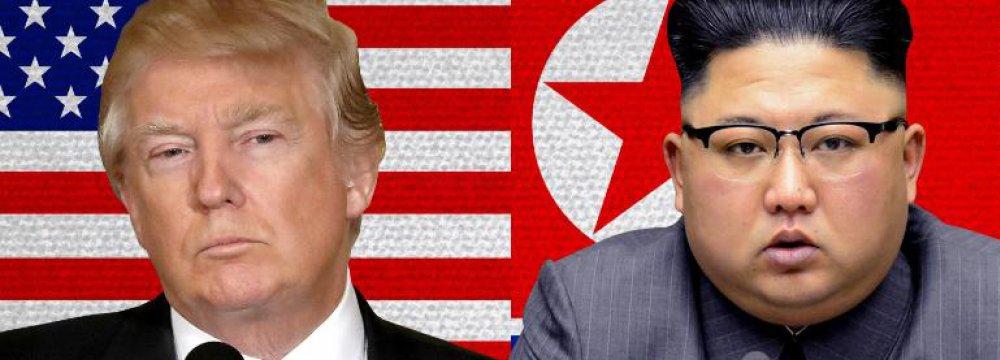 Donald Trump (L) and Kim Jong-un
