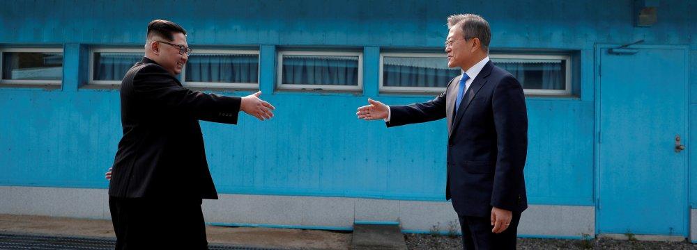 South Korean President Moon Jae-in (R) and North Korean leader Kim Jong-un at the truce village  of Panmunjom, South Korea on April 27