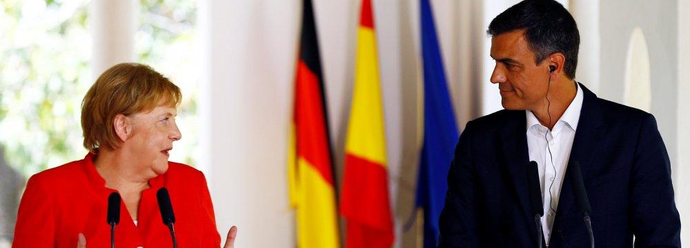 German Chancellor Angela Merkel and Spanish Prime Minister Pedro Sanchez hold a press conference at the Palacio de los Guzmanes in Sanlucar de Barrameda, Cadiz, on August 11.
