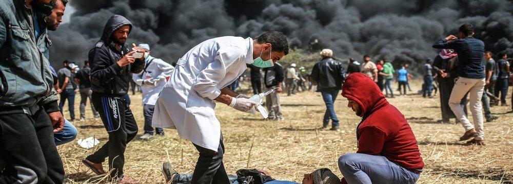 Palestinian Journalist Shot in Gaza Dies
