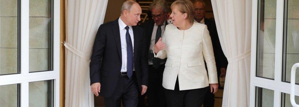 Putin, Merkel Discuss Defense Against US Sanctions Drive