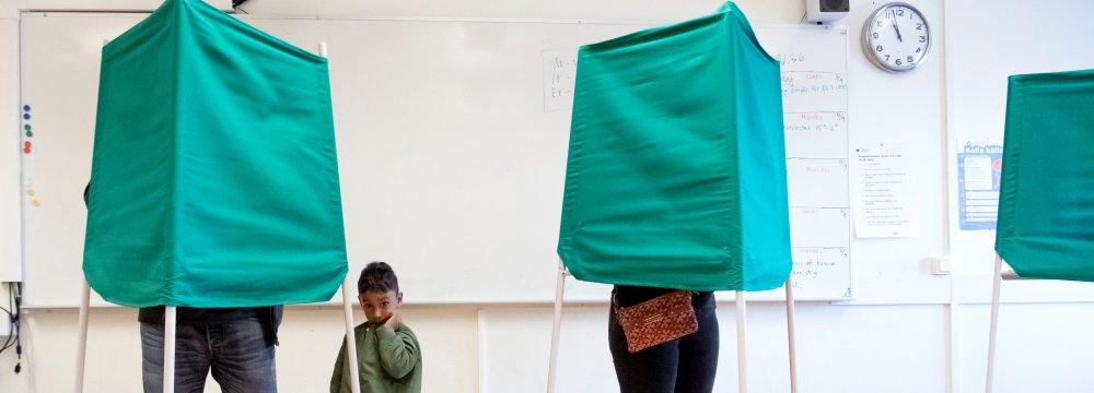 People at polling stations in Stockholm, Sweden, on September 9