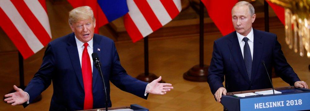 Donald Trump (L) and Vladimir Putin meet in Helsinki on July 16.