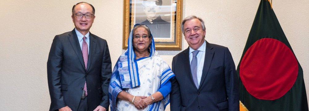 Prime Minister of Bangladesh Sheikh Hasina flanked by UN Secretary-General Antonio Guterres (R) and World Bank Group President Jim Yong Kim in Dhaka, Bangladesh on July 1
