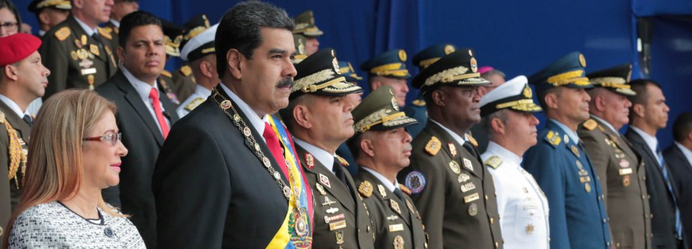 Venezuela's President Nicolas Maduro and his wife Cilia Flores attend a military event in Caracas on August 4.