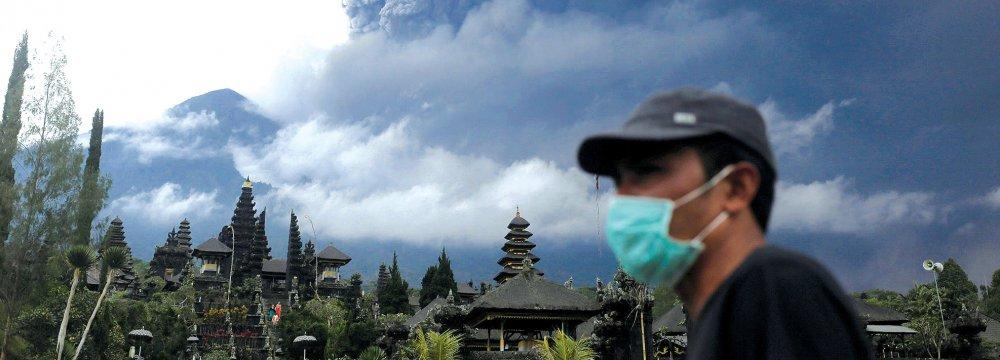Mount Agung volcano eruption seen from Besakih Temple in Karangasem on the Indonesian island of Bali.