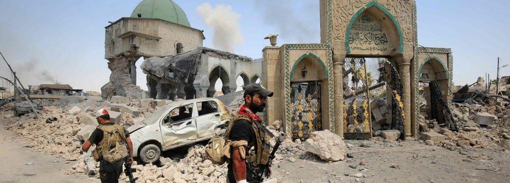 Members of Iraqi Counter Terrorism Service sift through the ruins of the Grand al-Nuri Mosque in Mosul, Iraq June 29.