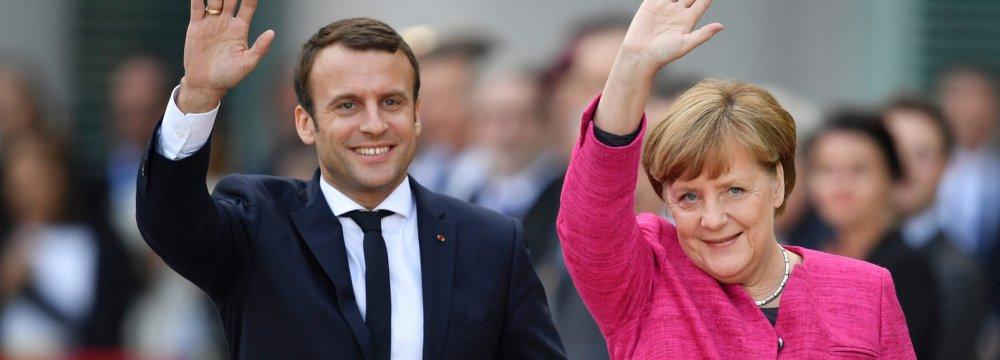 Merkel, Macron Plan Roadmap on Eurozone Reform