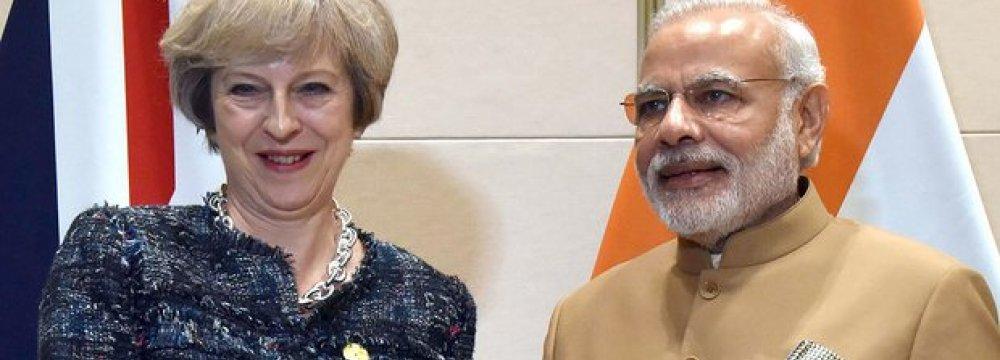 Theresa May (L) and Narendra Modi