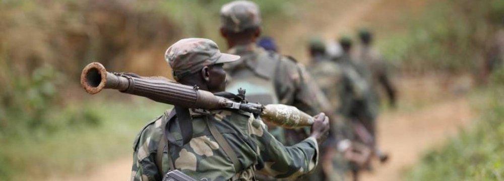 DR Congo military personnel patrol near Beni  in North Kivu Province.