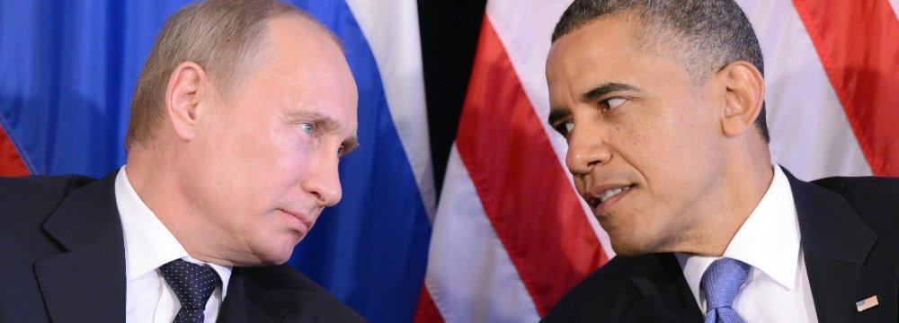 Vladimir Putin (L) with Barack Obama