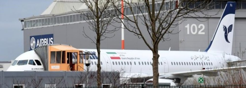 "An Airbus A321 with the Iranian flag and description ""The airline of the Islamic Republic of Iran"" is parked at the Airbus facility in Hamburg Finkenwerder, Germany, on Dec. 19."