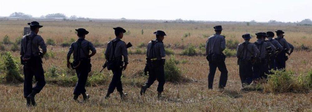 Myanmar police patrol near villages close to Rakhine state.