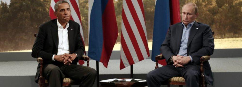 US President Barack Obama (L) meets with Russian President Vladimir Putin during the G8 Summit in Enniskillen, Northern Ireland, June 2013. (File Photo)