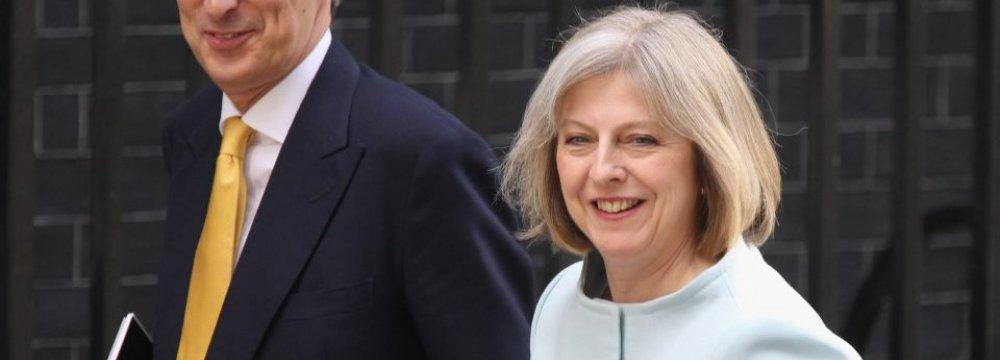 Theresa May (R) and Philip Hammond