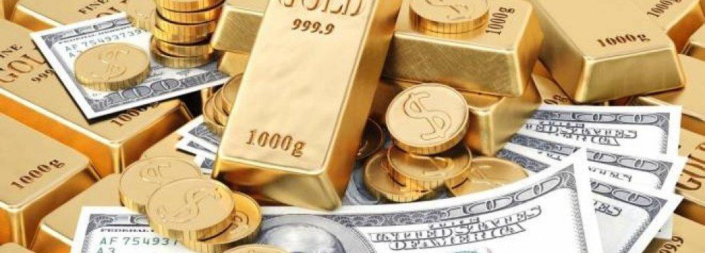 Gold Rises, Dollar Slips