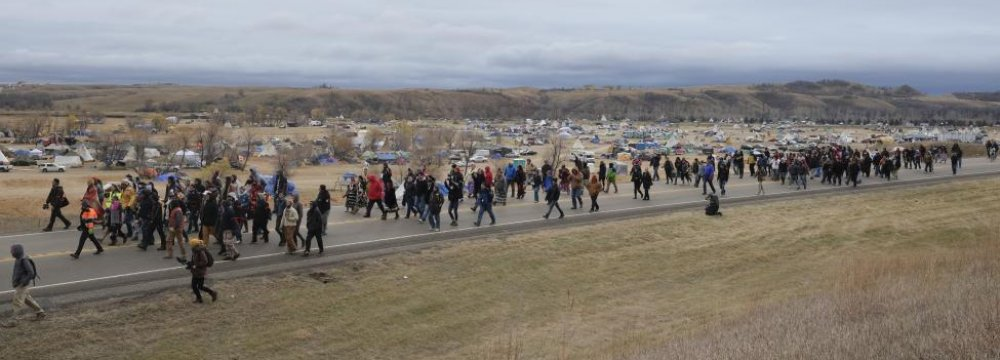 Hundreds of Native American and environmental protesters exit the Oceti Sakowin campground as they march toward a law enforcement barricade near the Dakota Access Pipeline construction site on Oct. 29.