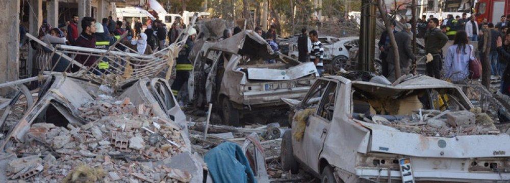 Damaged cars are seen on a street after a blast in Diyarbakir, Turkey, November 4.