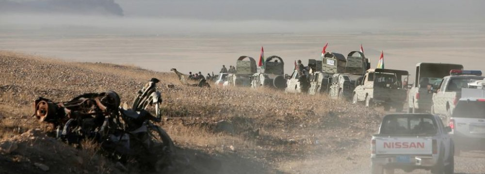 Peshmerga forces advance in the east of Mosul to attack IS terrorists in Mosul, Iraq, on Oct. 17.