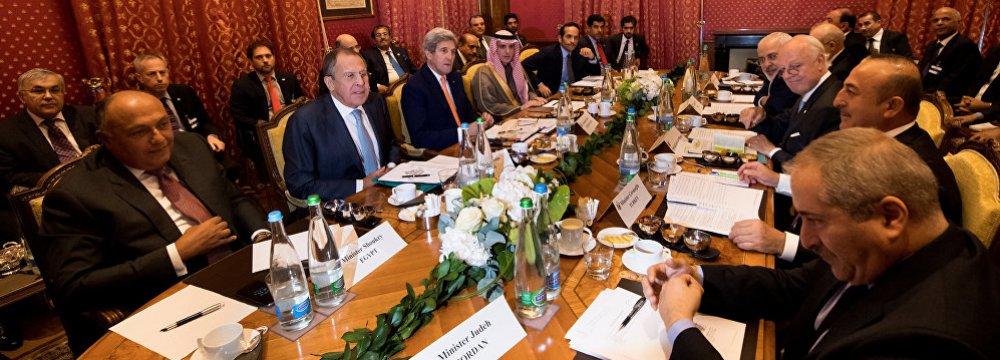 (From L-R): Egypt's FM Sameh Shoukry, Russia's FM Sergey Lavrov, US Secretary of State John Kerry, Saudi Arabia's FM Adel al-Jubeir, Qatar's FM Sheikh Mohammed bin Abdulrahman al-Thani, Iraq's FM Ibrahim al-Jaafari, Iran's FM Mohammad Javad Zarif, UN Special Envoy of the Secretary-General for Syria Staffan de Mistura, Turkey's FM Mevlut Cavusoglu and Jordan's FM Nasser Judeh meet in Lausanne, Switzerland, on Oct. 15.