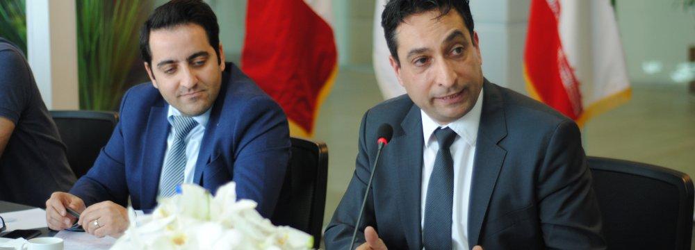 Peyman Kargar (R) addresses a press conference in Tehran on Oct. 17.