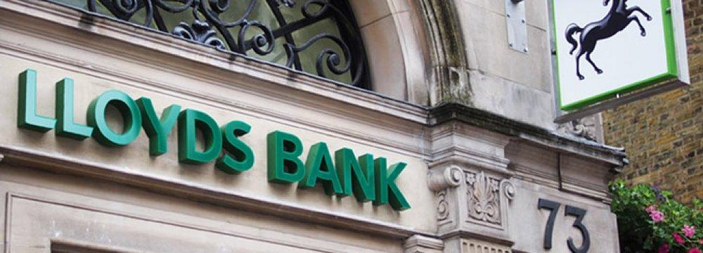 Lloyds Profits Dive