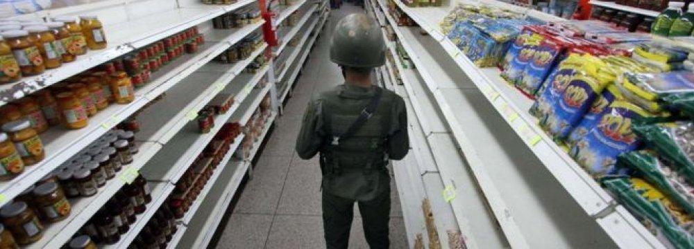 Venezuela Economy to Sink 8%
