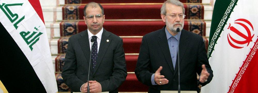 Iraqi Parliament Speaker Salim al-Jabouri (L) meets his Iranian counterpart, Ali Larijani, in Tehran on August 20.