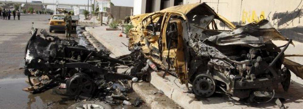 Baghdad Bombings Kill 14