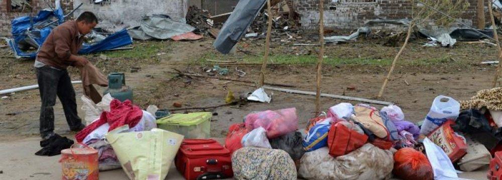 Storm Kills 98 in China