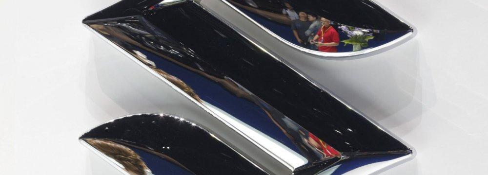 Japan Gov't Raids Suzuki, Mitsubishi