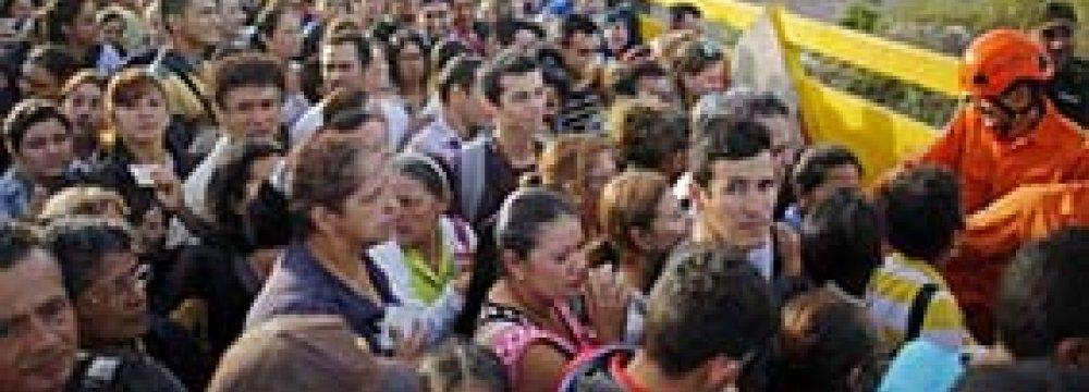 Venezuelans gather to cross the border into Colombia at the Simon Bolivar Bridge.