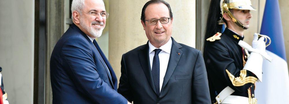 Hollande Zarif Discuss Ties, Mideast