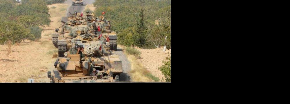 Turkish army tanks make their way towards the Syrian border town of Jarablus, Syria August 24.