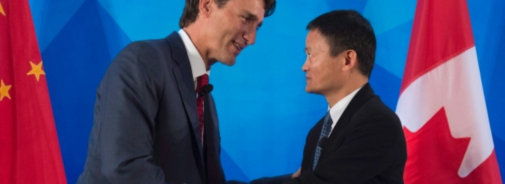 Justin Trudeau (L) and Jack Ma in Beijing.
