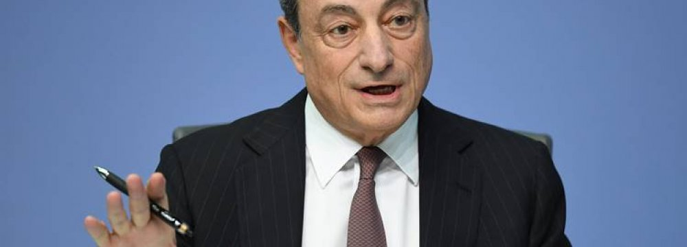Draghi Urges Review of QE Policy
