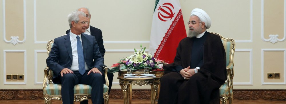 President of the French National Assembly Claude Bartolone (L) meets President Hassan Rouhani in Tehran on Sept. 6.