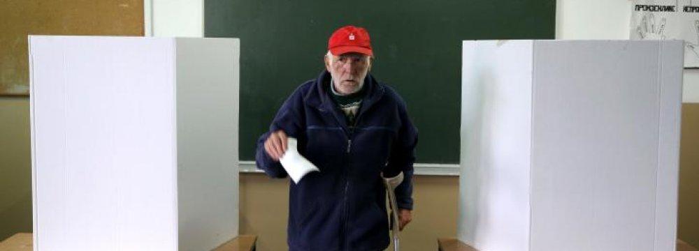 "A man votes during a referendum on ""Statehood Day"" in Laktasi near Banja Luka, Bosnia and Herzegovina, on Sept. 25."