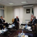 Kamal Kharrazi (R) talks with UK Junior Foreign Minister Alistair Burt in Tehran on Sunday.